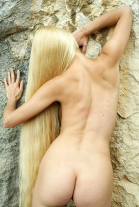 Naked-long-haired-blonde-posing-on-the-rocks-near-sea-16