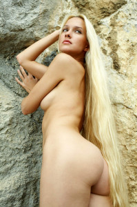 Naked-long-haired-blonde-posing-on-the-rocks-near-sea-19