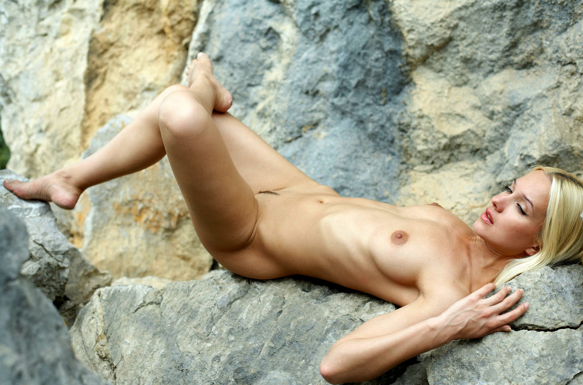 Really. busty nudist posing naked rocks