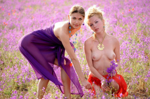 Two-slender-girlfriend-with-bright-scarves-at-floral-field-10
