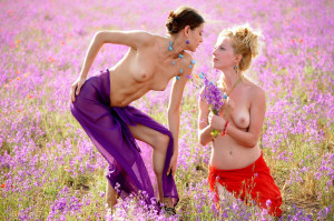 Two-slender-girlfriend-with-bright-scarves-at-floral-field-11