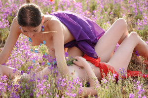 Two-slender-girlfriend-with-bright-scarves-at-floral-field-12
