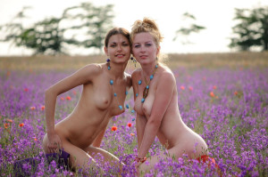 Two-slender-girlfriend-with-bright-scarves-at-floral-field-15