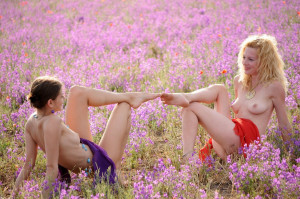 Two-slender-girlfriend-with-bright-scarves-at-floral-field-17