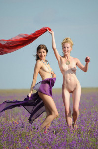 Two-slender-girlfriend-with-bright-scarves-at-floral-field-3