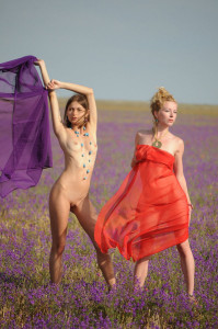 Two-slender-girlfriend-with-bright-scarves-at-floral-field-6
