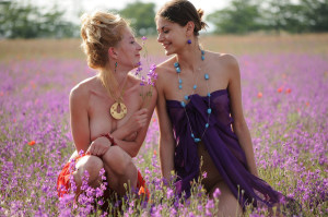 Two-slender-girlfriend-with-bright-scarves-at-floral-field-8