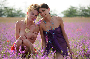 Two-slender-girlfriend-with-bright-scarves-at-floral-field-9