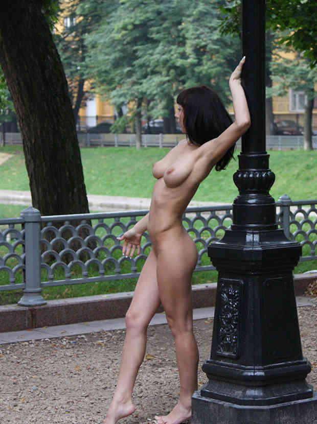 Amazing sporty brunette with ideal boobs posing naked at public streets