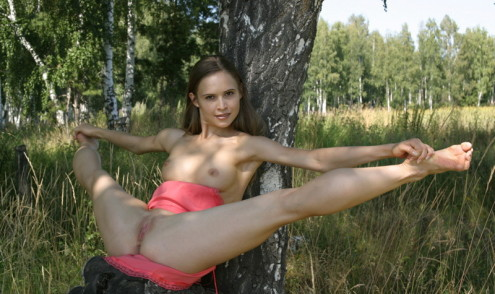 Athletic-girl-with-a-pink-skirt-shows-her-sweet-pussy-in-the-woods-11