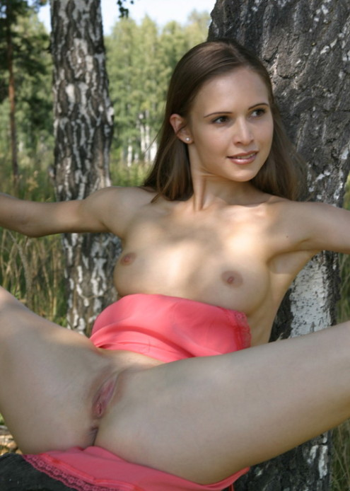 Athletic-girl-with-a-pink-skirt-shows-her-sweet-pussy-in-the-woods-13