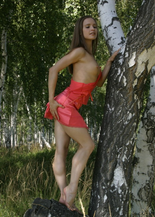 Athletic-girl-with-a-pink-skirt-shows-her-sweet-pussy-in-the-woods-2