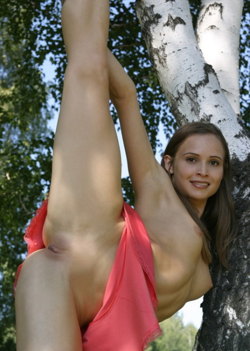 Athletic-girl-with-a-pink-skirt-shows-her-sweet-pussy-in-the-woods-9