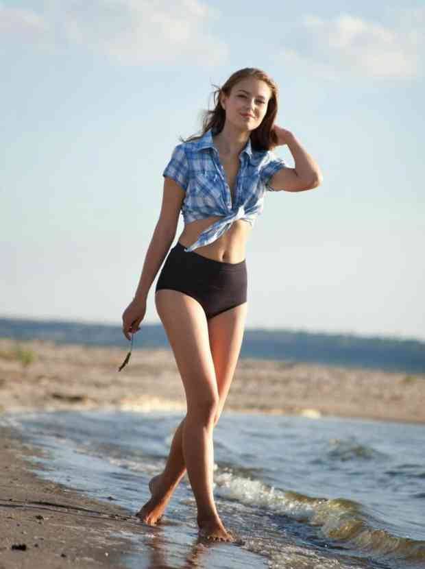 Gorgeous teen strips on the beach